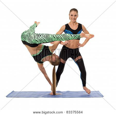 Acrobatic composition of pretty sporty girls
