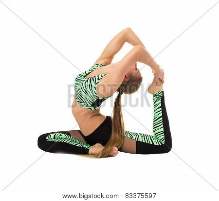 Sporty girl posing in difficult stretching pose