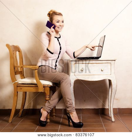 Businesswoman With Phone Touching Screen Laptop