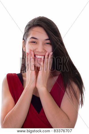 Beautiful Biracial Teen Girl In Red Dress Excited, Hands On Face, Smiling