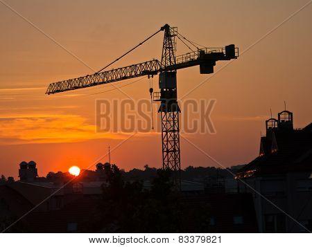 Big construction crane on a golden sunrise light in Belgrade