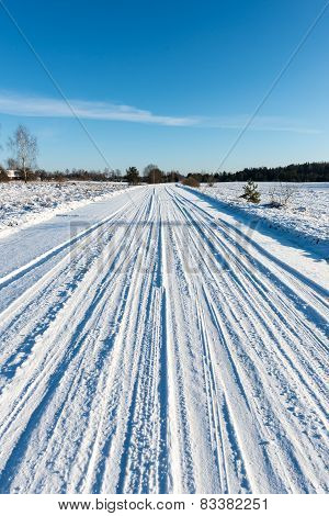 Snowy Winter Road With Tire Markings