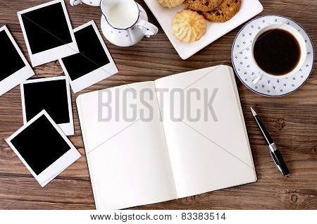 Photo Album With Coffee And Biscuits
