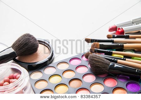 Make-up multicolored palette, brushes and cosmetics.