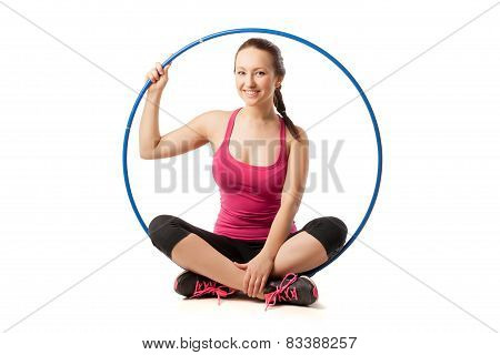 Beautiful woman sitting with color hula hoop
