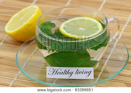 Healthy living card with cup of mint tea with lemon