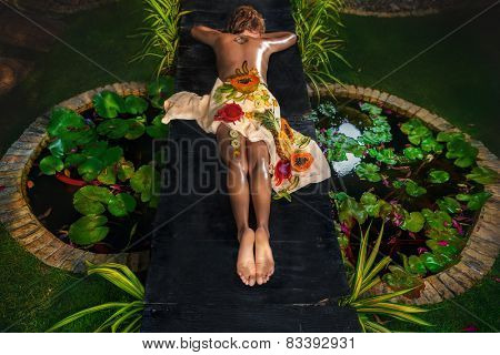 Woman lying in natural spa salon