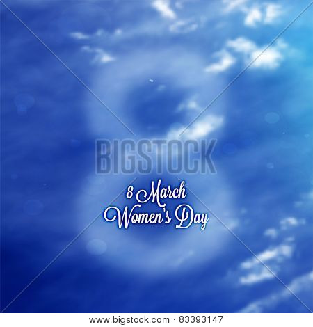International Women's Day, 8 March. Smooth Spring Blue Sky with Clouds, Blurred Digit 8 and Label for Holiday Design. Abstract Background.