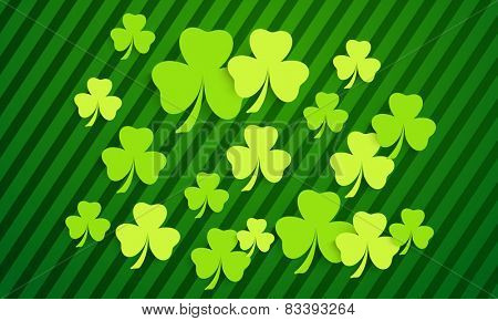 Happy St. Patrick's Day background with shiny shamrock leaves.