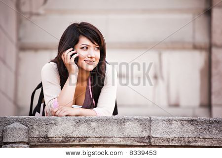 Mixed Race Student On The Phone