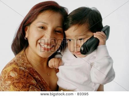 Mother With Son On Telephone