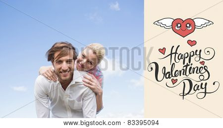 Handsome man giving piggy back to his girlfriend against happy valentines day