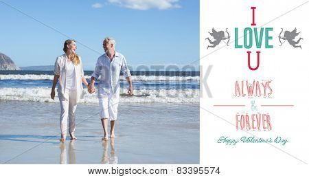 Happy couple walking barefoot on the beach against i love you message