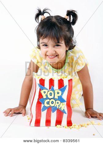 toddler eating popcorn