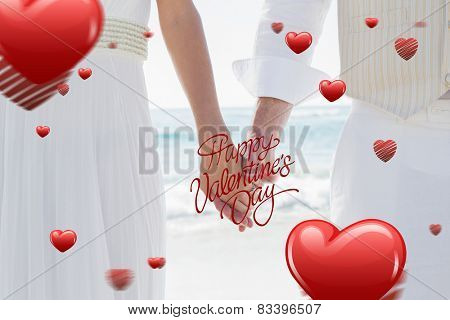 Newlyweds holding hands against happy valentines day