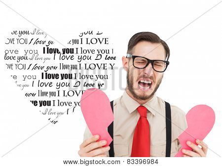 Geeky hipster crying and holding broken heart card against valentines day pattern