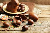 foto of chocolate spoon  - Chocolate Easter Eggs on wooden background - JPG