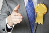 stock photo of politician  - Close Up Of Politician Reaching Out To Shake Hands - JPG
