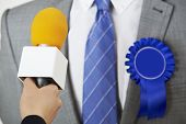 picture of politician  - Politician Being Interviewd By Journalist During Election - JPG