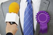 stock photo of politician  - Politician Being Interviewd By Journalist During Election - JPG