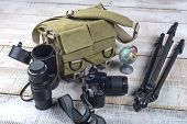 stock photo of megapixel  - Bag and appliances for photography top view - JPG