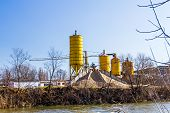 pic of silo  - Gravel pit with a several silos and belts along with large piles of various grades of gravel - JPG