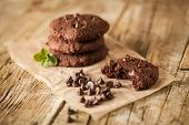 pic of chocolate-chip  - Double chocolate chip cookies with mint on wood - JPG