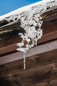 pic of icicle  - Winter icicle hanging from a house roof - JPG