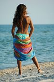 stock photo of denude  - Beautiful sexual girl brunette topless with towel on beach - JPG
