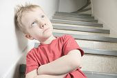 foto of neglect  - Neglected lonely child leaning at the wall - JPG