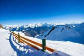 stock photo of caucus  - Panorama of Caucus winter resort mountains and wooden fence on top of the peak - JPG