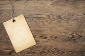 stock photo of wooden table  - price tag on old wooden table background - JPG