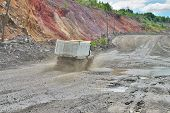 foto of iron ore  - Dump truck driving along the iron ore opencast - JPG