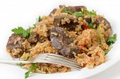 foto of liver fry  - lightly fried lambs liver chunks baked on top of a pilaf of rice - JPG