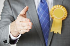 pic of politician  - Close Up Of Politician Reaching Out To Shake Hands - JPG