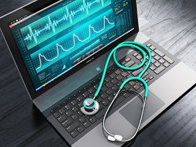 stock photo of beating-heart  - Laptop or notebook computer PC with medical cardiologic diagnostic test software on screen and stethoscope on black wooden business office table - JPG