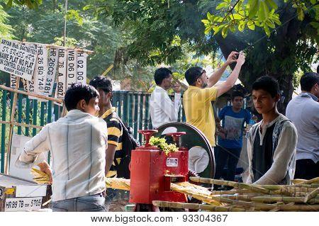 Sugarcane Juice Vendor Extracting Juice