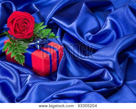 Gift With Rose On Silk Fabric