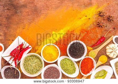 Mix Spices On Wood Texture Background.