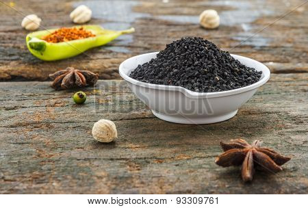 The Nigella Seed On Wood Texture For Design Or Decorate Project.