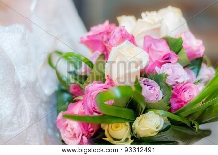 Soft focus glow effect bridal bouquet of pink purple and white roses