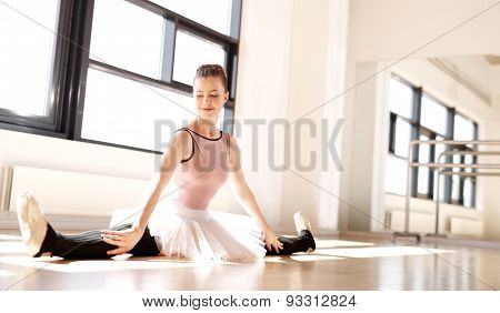 Pretty Ballerina Splitting Her Legs On The Floor
