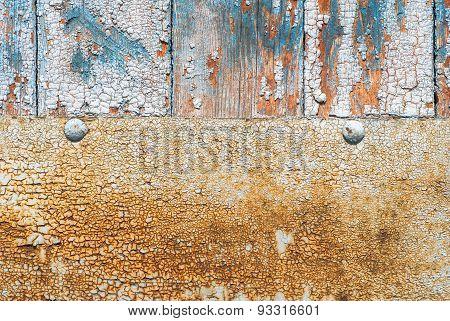 door of planks reinforced sheet of rusty metal texture background