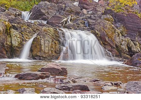 Rocky Cascade In The Mountains