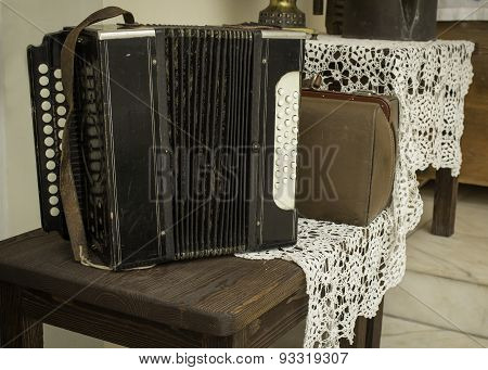 Vintage Accordion Standing On The Wooden Table