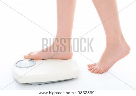 Legs of a woman on weighting machine