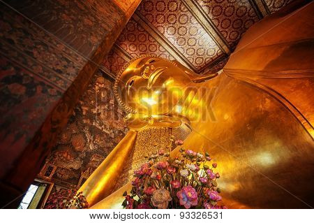 Bangkok, Thailand - February 11, 2014: Statue of the Reclining Buddha inside the Wat Pho temple.