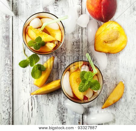 Glasses Of Peach Iced Tea.