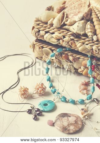 A Collection Of Jewelry In Jewelry Box Decorated With Seashells.