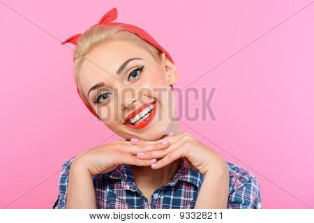 Beautiful pin up girl isolated on pink
